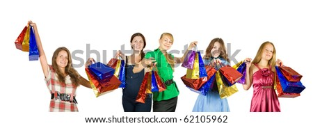 Group of   girls with shopping bags. Isolated over white background - stock photo