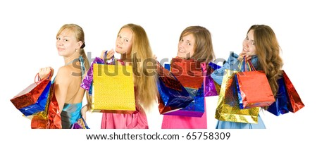Group of   girls with shopping bags. Isolated over white background