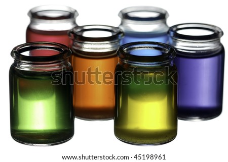 Group of glasses filled with colorful liquid isolated on white - stock photo
