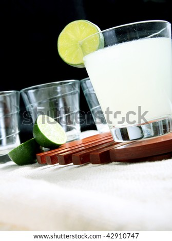 Group of glasses with Glass with lemonade and slice of lemon over black background - stock photo