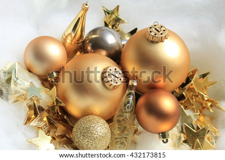Group of golden christmas decorations in various shapes