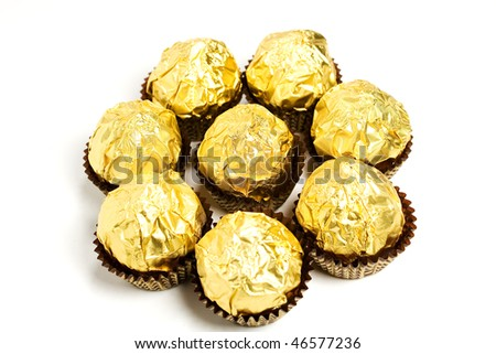 Group of golden foil wrapped candies - stock photo