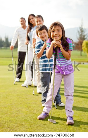Group of golf players smiling at the course - stock photo