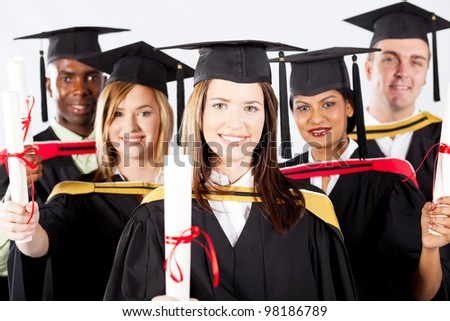 group of graduates in graduation gown and cap - stock photo
