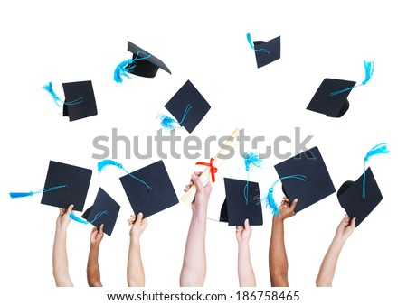 Group of Graduating Student's Hands Holding and Throwing Graduation hats as a Sign of Celebration - stock photo