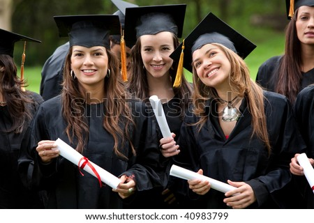 group of graduation students looking happy outdoors - stock photo