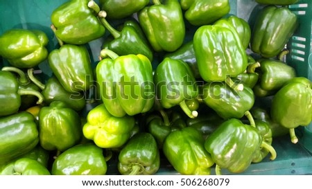 group of green capsicum in the market