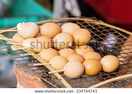 Group of Grilled chicken eggs on the grill, close up - stock photo
