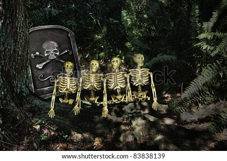 Group of grungy looking skeletons coming out of their grave on a dark night at Halloween or Cinco De Mayo - stock photo