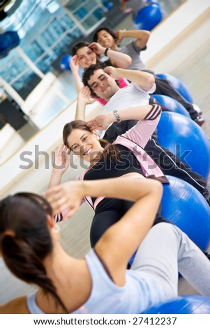 group of gym people at a pilates class - stock photo