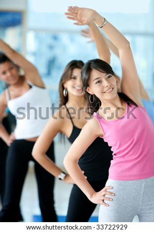 group of gym people in an aerobics class - stock photo