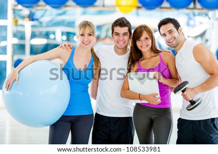 Group of gym people looking very happy - stock photo