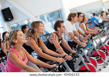 Group of gym people on machines