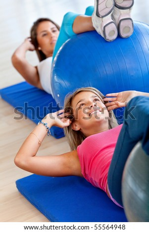 group of gym women in a pilates class - stock photo