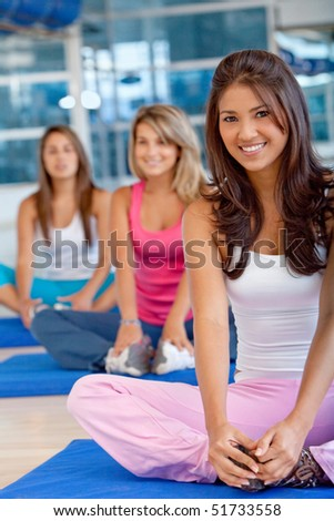 group of gym women in a stretching class - stock photo