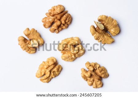 group of halves of walnut on white - stock photo