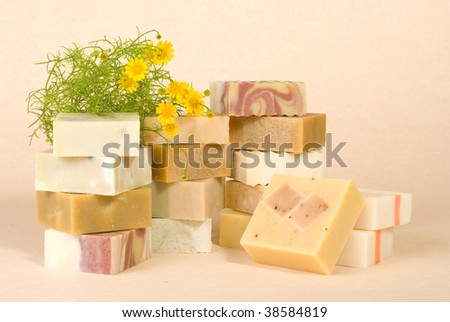 group of handmade soap with herbal material, soap stack. - stock photo