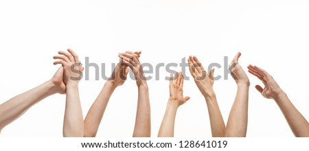 Group of hands applauding on white background - stock photo