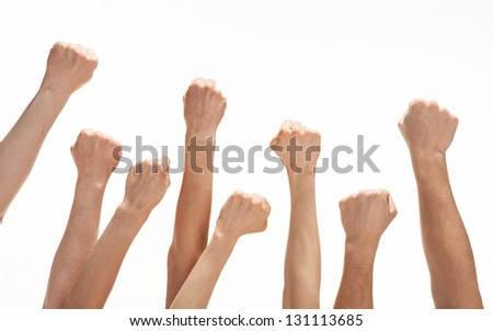Group of hands (fists) raised up - stock photo