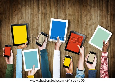 Group of Hands Holding Digital Devices with Copy Space - stock photo