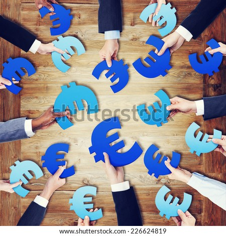 Group of Hands Holding European Currency Symbol - stock photo