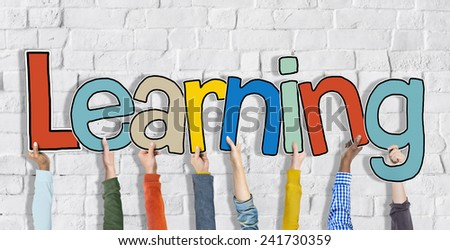 Group of Hands Holding Learning Word Concept - stock photo