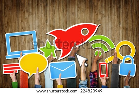 Group of Hands Holding Technology Symbols - stock photo