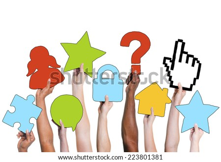 Group of Hands Holding Various Symbols - stock photo