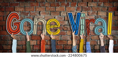 Group of Hands Holding Word Gone Viral - stock photo