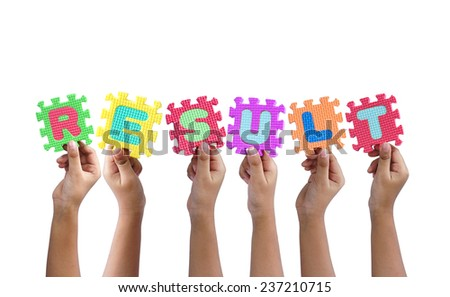 group of hands holding word result - stock photo