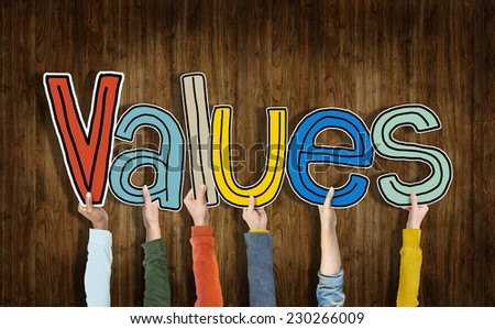 Group of Hands Holding Word Values - stock photo