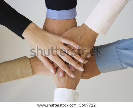 Group of hands together on top of each other. - stock photo