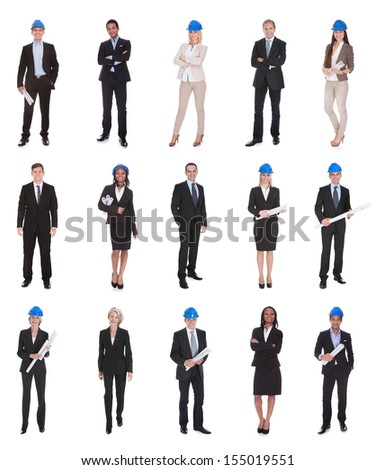 Group Of Happy Architects Holding Blue Print Over White Background - stock photo