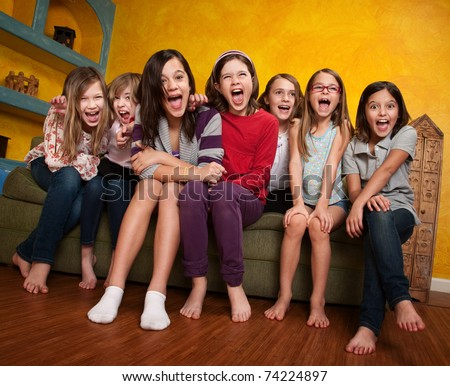 Group of happy barefoot girlfriends scream out - stock photo