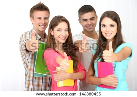 Group of happy beautiful young students at room - stock photo