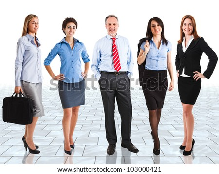 Group of happy business people in a bright room - stock photo