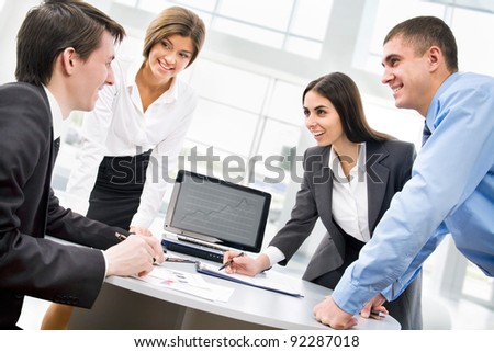 Group of happy business people in a meeting at office - stock photo