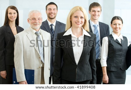 Group of happy business people standing together - stock photo