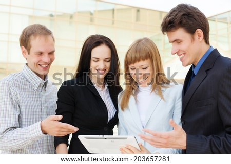 Group of happy business people talking outside - stock photo