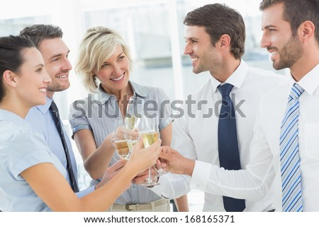 Group of happy business team toasting with champagne in the office - stock photo