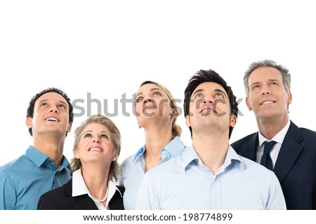 Group Of Happy Businesspeople Looking Up Over White Background - stock photo