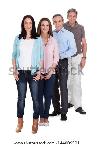 Group Of Happy Businesspeople Standing In Row Isolated Over White Background - stock photo