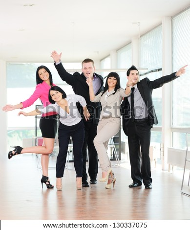 Group of happy cheerful casual businesspeople smiling together and having fun - stock photo