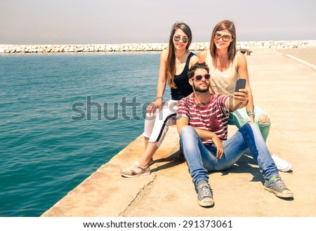 Group of happy cheerful friends having fun taking selfie with mobile phone - Smart teenagers students using modern technology in summer time - Vintage filter for friendship youth lifestyle concept   - stock photo