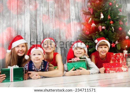 Group of happy children in Christmas hat with presents  - stock photo