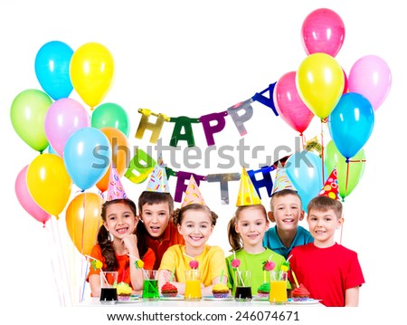 Group of happy children in colorful shirts having fun at the birthday party - isolated on a white. - stock photo