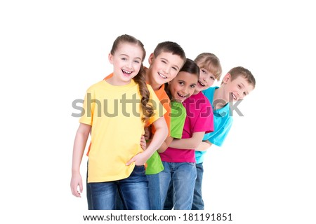 Group of happy children in colorful t-shirts stand behind each other on white background. - stock photo