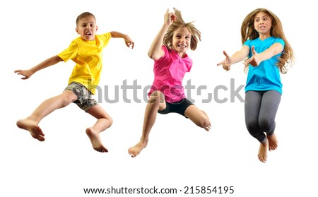 group of happy children jumping and having fun isolated over white - stock photo