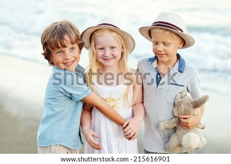group of happy children on a beach .friendship. - stock photo