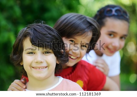 Group of happy children outside - stock photo